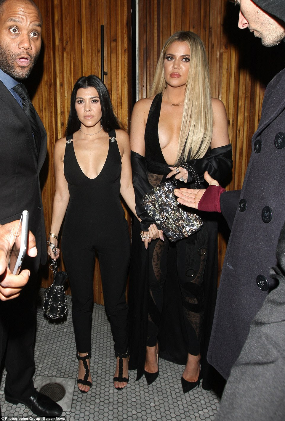 Mixing it up: Kourtney (left) and Khloe Kardashian showed off their height difference as they posed for snaps outside Gigi Hadid's 21st birthday bash at The Nice Guy in West Hollywood on Thursday night