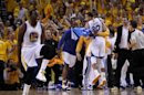 Golden State Warriors Stephen Curry (R) and Draymond Green celebrate against the Denver Nuggets during Game 4 of their NBA Western Division quarter-final basketball playoff game in Oakland