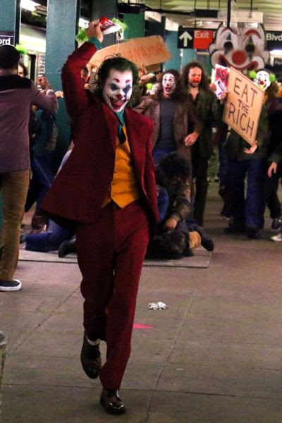 The Joker (Joaquin Phoenix) is up to no good inside a New York subway station in this snapshot from the set of JOKER.