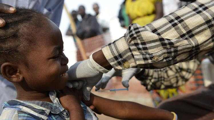 A child receives a vaccine in a makeshift field clinic of the Doctors Without Borders (MSF) organisation in Bangui on January 7, 2014