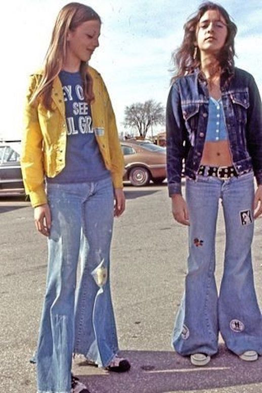 Le Fashion Blog 1970s 70s Street Style Vintage Photos Flare Jeans Wide Leg Bell Bottoms Sneakers Via Tres Blase