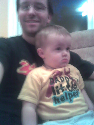 Oliver (and Julien) sitting on Daddy's lap