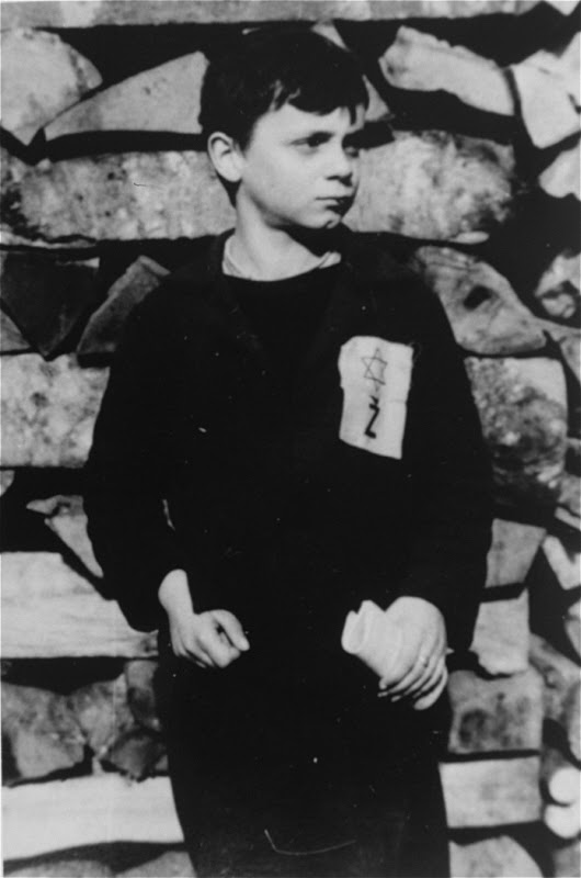 """A Jewish child wears the compulsory Star of David badge with the letter """"Z"""" for Zidov, the Croatian word for Jew. Yugoslavia, probably 1941."""