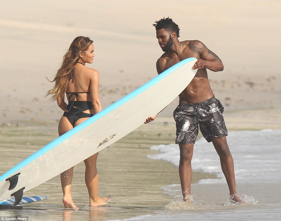 Can I carry this board for you? Derulo looked to be in top shape as he pulled the heavy board into the ocean