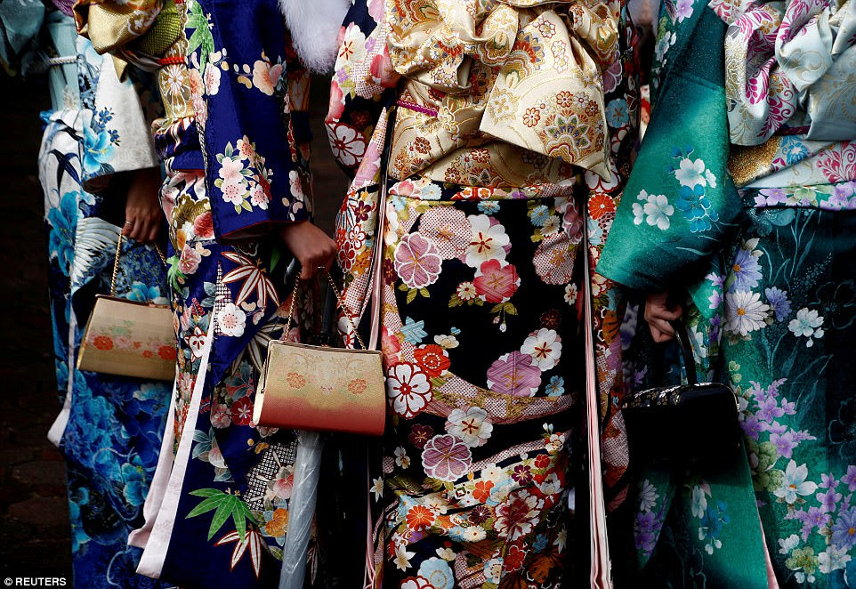 Japanese women wearing kimonos attend their Coming of Age Day celebration ceremony at an amusement park in Tokyo, Japan, on January 9