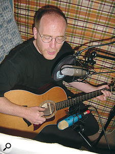 Recording avocalist with two figure‑of‑eight mics can produce very good results. If the performer wants to play and sing at the same time, careful positioning to reject the unwanted sound from both mics (the vocals from the guitar mic and the guitar from the vocal mic) can achieve excellent separation.