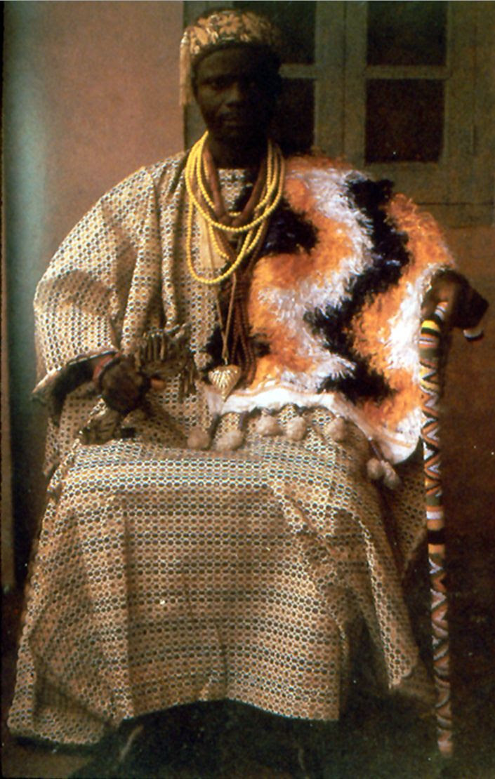 Africa | Adesina Adeyemi dressed in his official attire as a high ranking chief.  He wears an Itagbe over his shoulder | Ijebu-Ife, June 1978