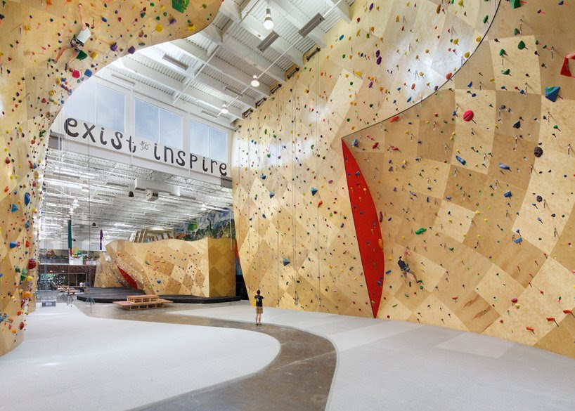 brooklyn boulders coworking space features towering rock climbing wall