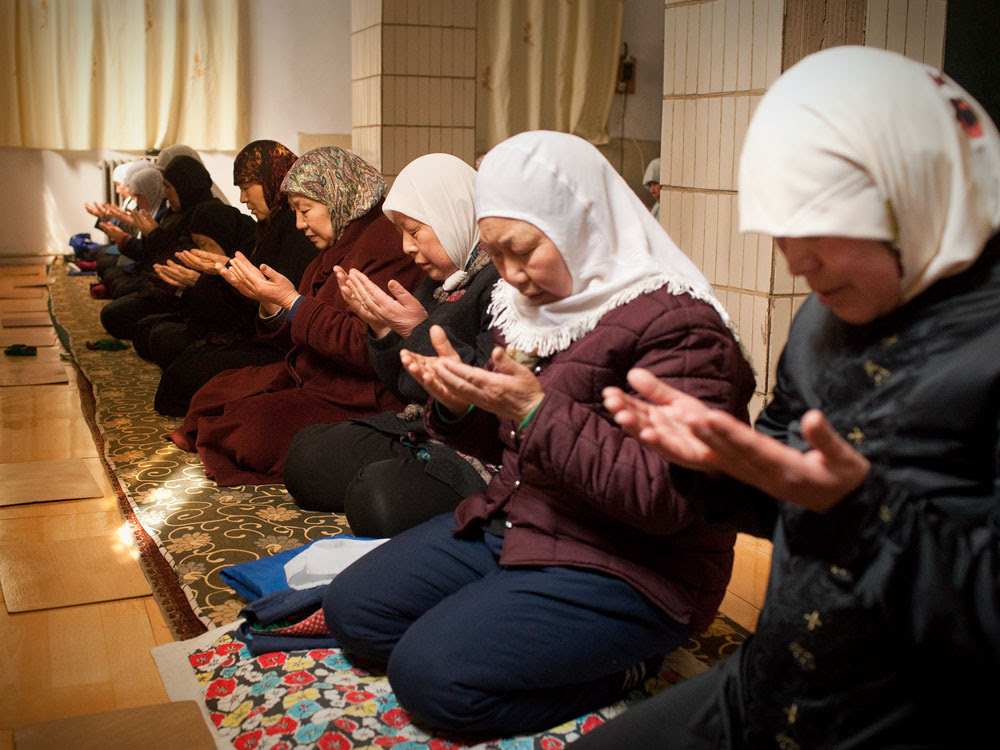 The faithful pray  at a mosque for somen