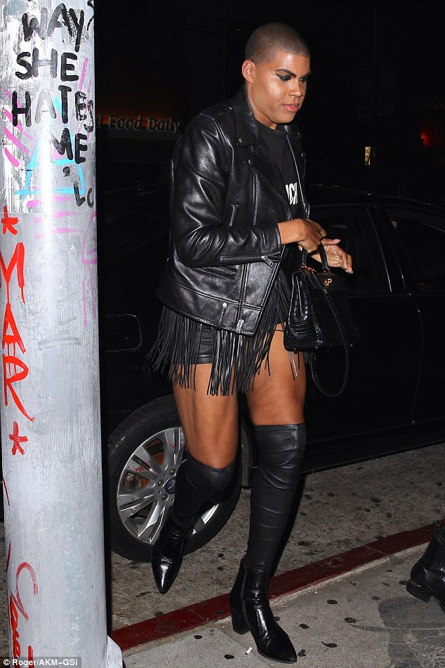His look: EJ wore a designer T-shirt underneath a leather jacket.The reality star added a pair of mini shorts, layered under a fringe, skirt-like belt