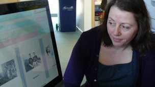 Dementia strategy project manager Beth Swanson browses the music choices on the interactive screen