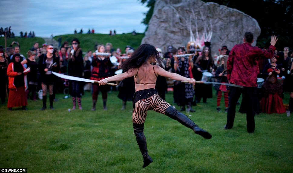 In full flow: This woman did not let the wet weather spoil her enjoyment of the summer solstice celebrations at Avebury
