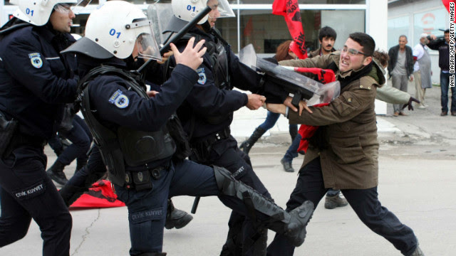 A leftist clashes with Turkish policemen during a protest against NATO Patriot missiles on January 21 in Adana.