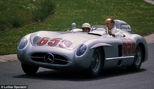 World beater: Stirling Moss drives his Mercedes-Benz 300 SLR at the Nurburgring in 1977