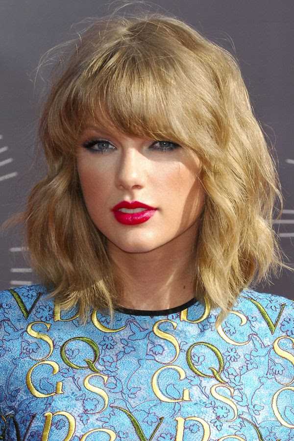 Taylor Swift's hair cut is between a baby bob and a lob,