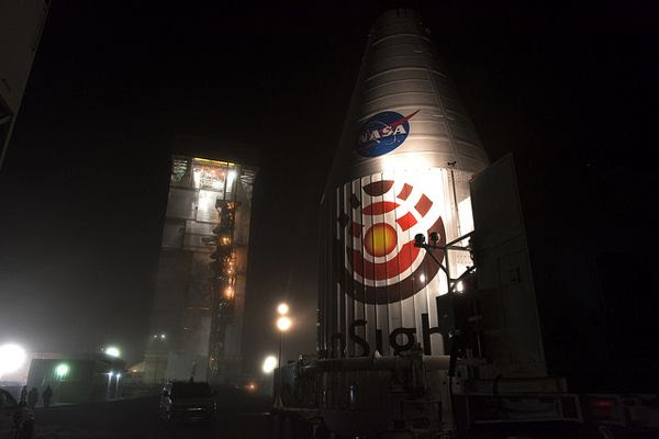 The Atlas V payload fairing that enshrouds NASA's InSight Mars lander is transported to Space Launch Complex 3 at Vandenberg Air Force Base in California...on April 23, 2018.