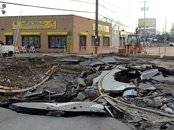 The site of Monday´s huge water main break at Frankford and Torresdale Avenues is quiet December 27, 2013. Workers are to begin putting in shoring and excavating down 20 feet to the site of the break. They hadn´t started as of 3pm Friday.  ( TOM GRALISH / Staff Photographer )