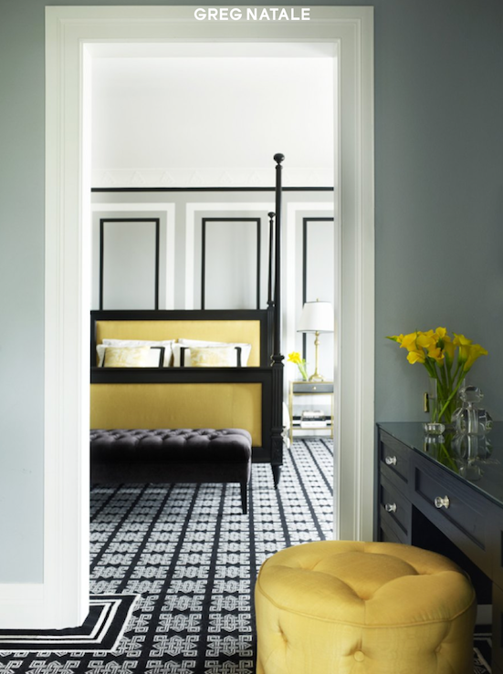 bedrooms - gray walls yellow black poster bed black tufted bench yellow silk tufted ottoman black geometric rug black built-in vanity  Greg Natale