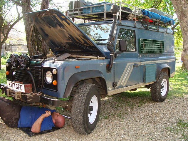 Dave performing maintenance work on Ollie & Jenny's Defender