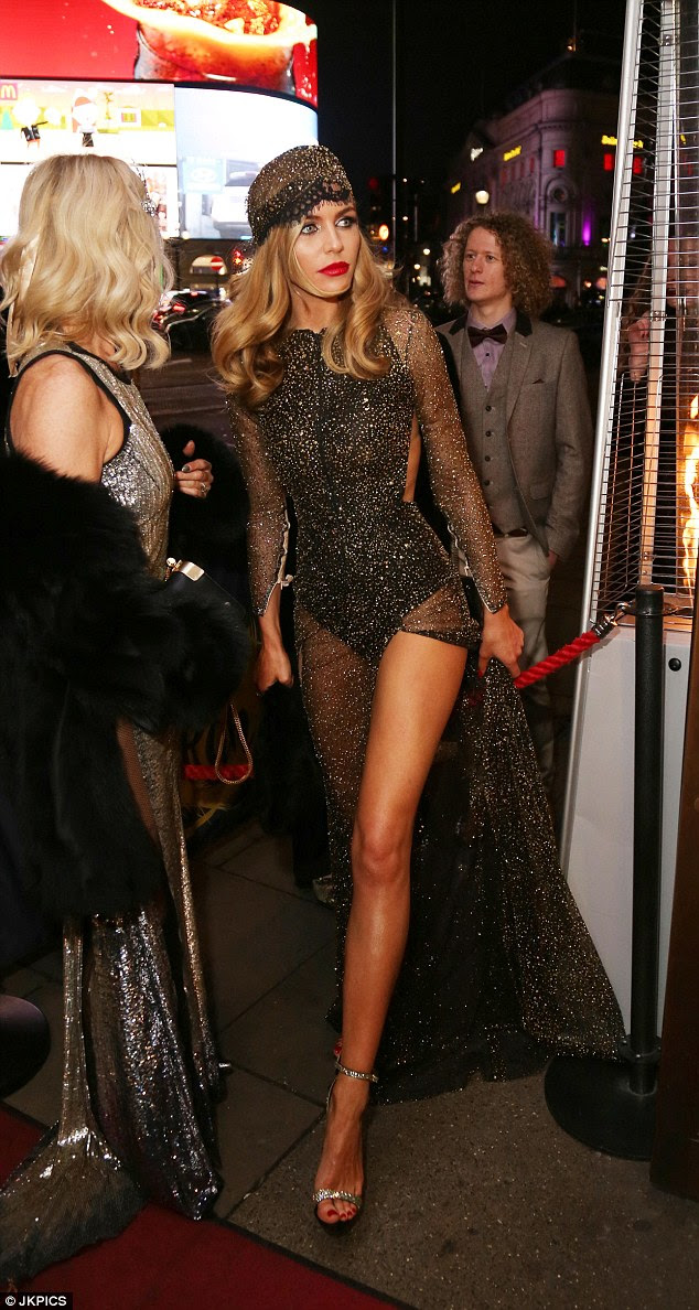 Showstopper: Her elegant frame was inch perfect, with the dress's sheer sleeves and thigh-high split showcasing her gym-honed arms and pins