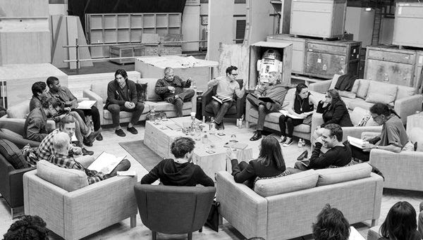 Director J.J. Abrams (sitting to the right of upper center) confers with Harrison Ford during a table read of STAR WARS: THE FORCE AWAKENS in London...on April 29, 2014.