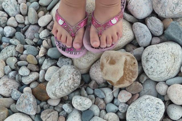 Dova stands on rocks