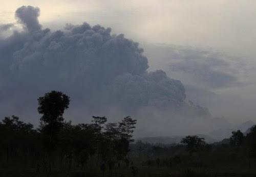 Ash raises from Mount Kelud's eruption, as seen from Sugih Waras village