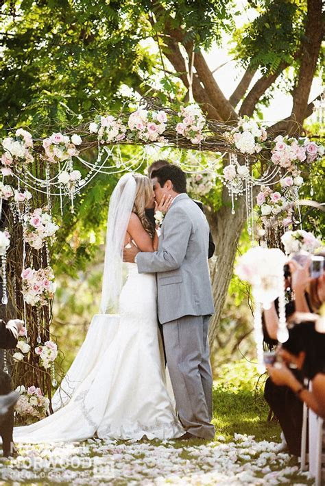 Outdoor wedding ceremony romantic arbor   OneWed.com