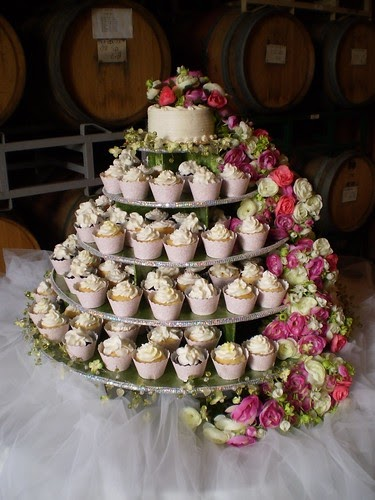 wedding cake and cupcake display ideas wedding cupcake tower featuring cupcake couture wrappers 21728
