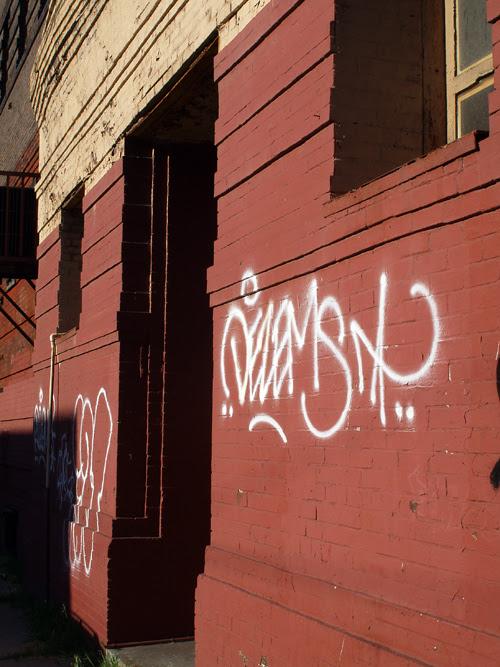 wall with large tag graffiti