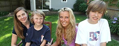 Kris Sonnenberg, 38, left, sits with her 8-year-old son Mike, 17-year-old daughter Elise, and 12-year-old son Charlie in their backyard Tuesday, May 25, 2010 in Chicago. (AP Photo/Kiichiro Sato)