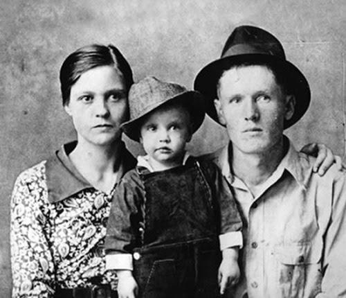 Elvis Presley & Parents, 1937.