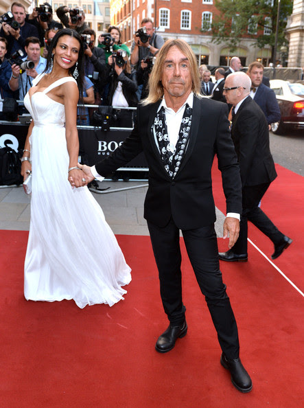 Iggy Pop and Nina Alu attend the GQ Men of the Year awards at The Royal Opera House on September 2, 2014 in London, England.