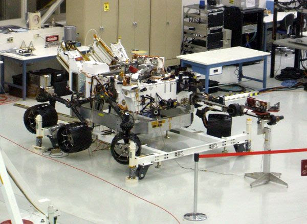 The CURIOSITY Mars rover on display inside the Spacecraft Assembly Facility.