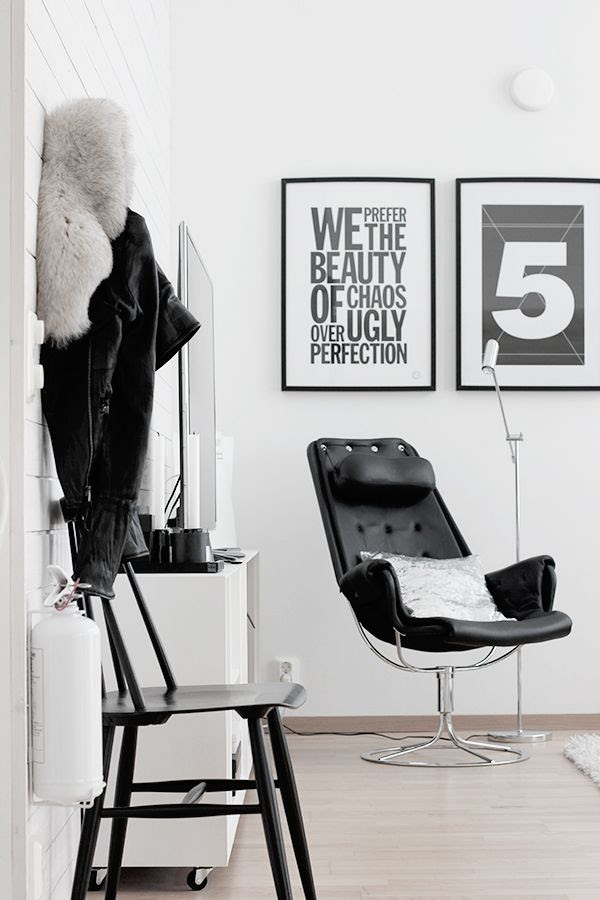 LE FASHION BLOG HOME DECOR INSPIRATION MIJA THE SUPER ORDINARY SWEDISH INTERIOR DESIGN BLOGGER BLACK AND WHITE FASHION RELATED DETAILS LIVING ROOM BLACK LEATHER CHAIR WITH SILVER METAL DETAILS BLACK WHITE WALL PRINTS FRAMED PRINTS WHITE TV STAND LEATHER SHEARLING JACKET PALE WOOD FLOORS METALLIC SILVER THROW PILLOW MINIMAL SILVER READING FLOOR LAMP 12 photo LEFASHIONBLOGHOMEDECORINSPIRATIONMIJATHESUPERORDINARY12.jpg