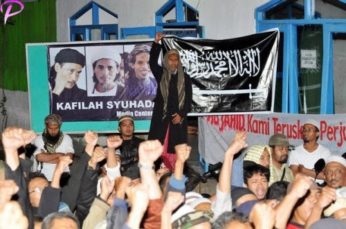 """Brother of the two convicted 2002 Bali bombers Amrozi and Mukhlas, Jafar Shodiq (C, standing) shouts """"God is great"""" along with supporters, at Al Islam boarding school in Tenggulun in the early morning of November 9, 2008 as they hear news that the three Bali bombers have been executed. Three Islamists sentenced to death for the Bali bombings which killed 202 people were executed by firing squad at midnight, local television reported. Amrozi, 47, his brother Mukhlas, 48, and ringleader Imam Samudra, 38, were killed with shots to the heart on the island prison of Nusakambangan off southern Java, TV One television reported quoting an official source."""