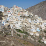 The pastel homes of Olympos village.