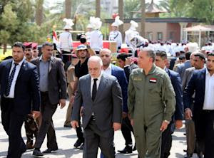 A handout picture released by the Iraqi Prime Minister's…