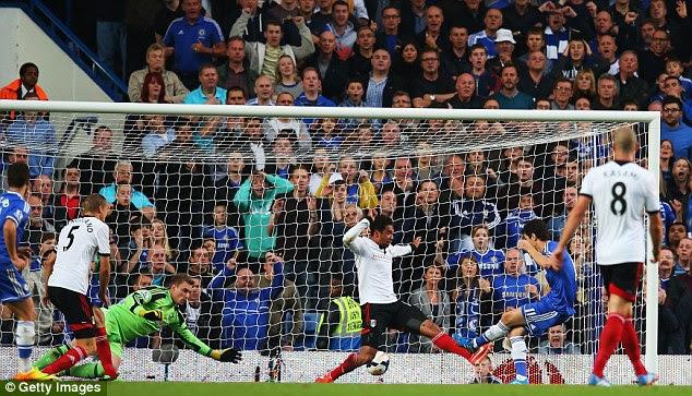On target: Oscar breaks the deadlock at Stamford Bridge