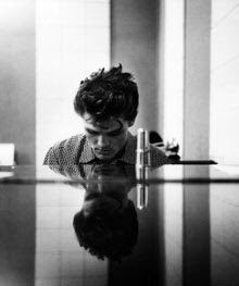 Chet Baker at a piano, photographed by William Claxton