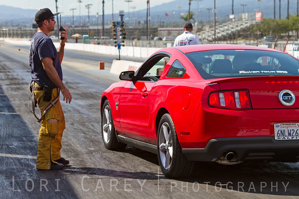 Automotive and gaming journalists test their reaction time behind the wheel of an Edelbroci-supercharged Mustang at Irwindale Dragstrip during the press launch of Racing Rivals