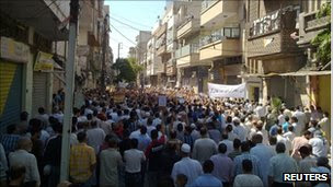An image purporting to show people protesting against Syrian President Bashar al-Assad after Friday prayers in the city of Homs on 16 September 2011