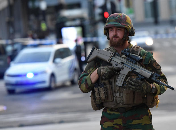 A soldier guards a cordoned-off area outside Brussels' Central station on June 20, 2017, after a reported explosion in the Belgian capital.