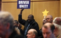 Seattle passes law letting Uber, taxi drivers       unionize