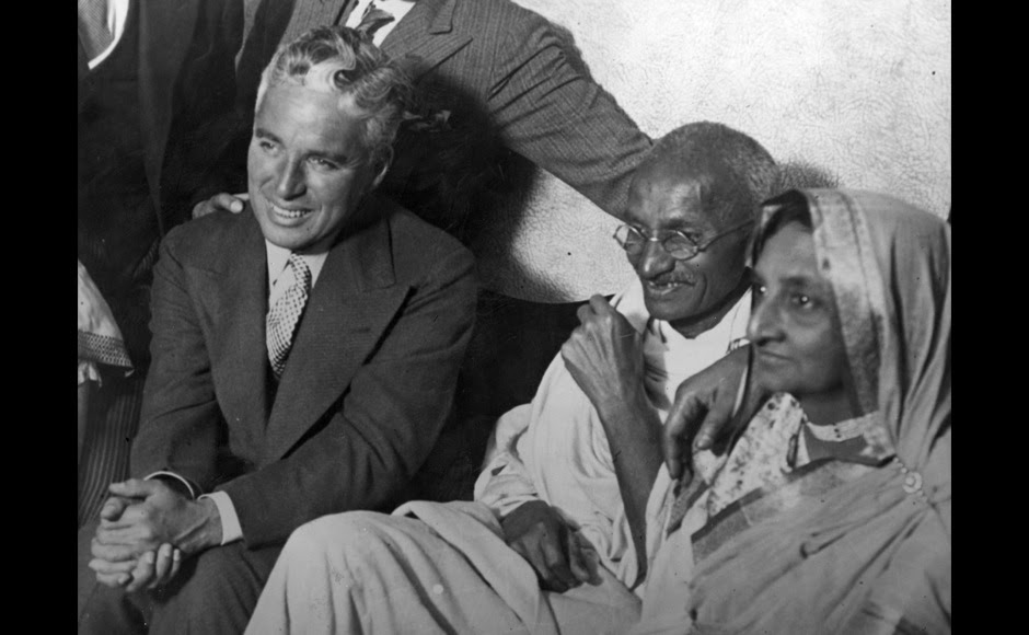 <p> Mahatma Gandhi and Kasturba meet Charlie Chaplin at the home of Dr Katral in Canning Town, east London. Getty Images</p>