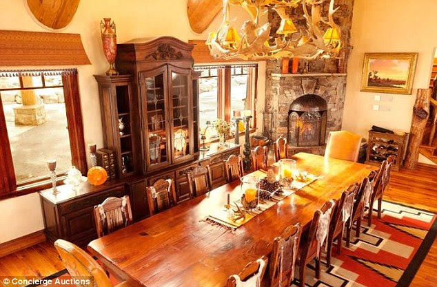 Eating in: The house features a dining room that accommodates 14 around a long, African Mahogany wood table in leather seats covered in cowhide vests, and is lighted by an antler chandelier