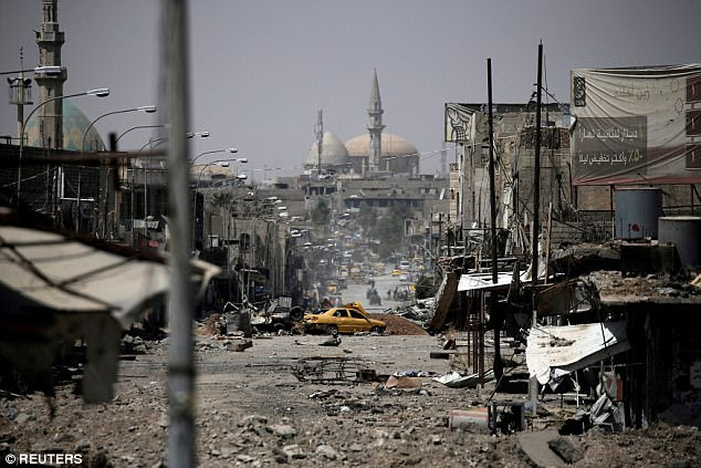 The Pentagon said today that it had no information to corroborate the claims that al-Baghdadi had been killed last week. Pictured: War-ravaged Mosul in May