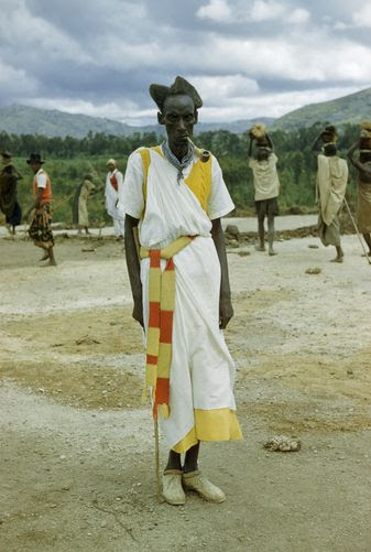 Africa | Watusi man wears sneakers but dresses his hair in old-fashioned way. Near Nyiragongo, Belgian Congo.  1950s. | ©W Robert Moore