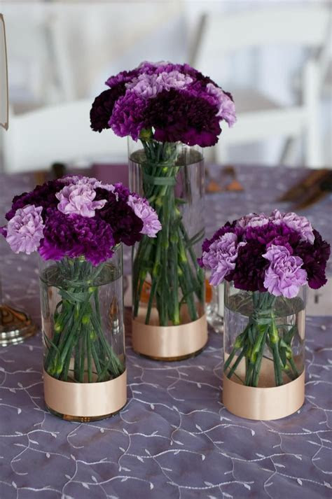 Trio of cylinder vases with varying shades of purple