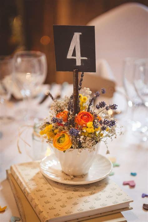 Rustic Romantic Barn Wedding. Table decor with tea cups